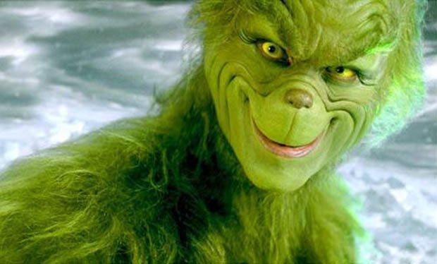 Ein grinsender, grüner Grinch.