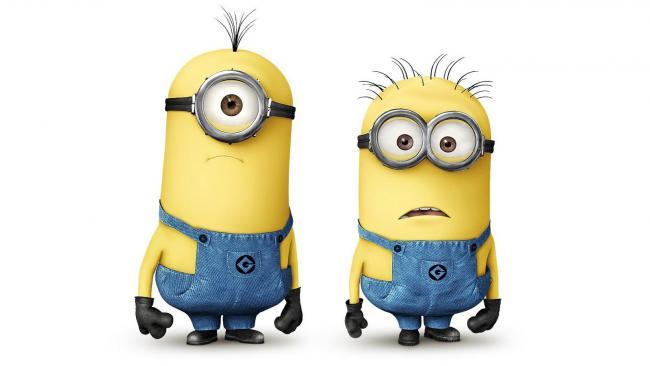zwei gelbe Minions in Arbeitskleidung und Schutzbrillen