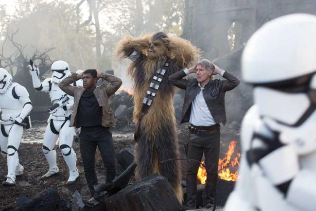 Finn (John Boyega), Chewbacca (Peter Mayhew), and Han Solo (Harrison Ford)