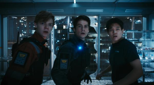 Dylan O'Brian (Thomas), Thomas Brodie-Sangster (Newt) und Ki Hong Lee (Minho) in Maze Runner